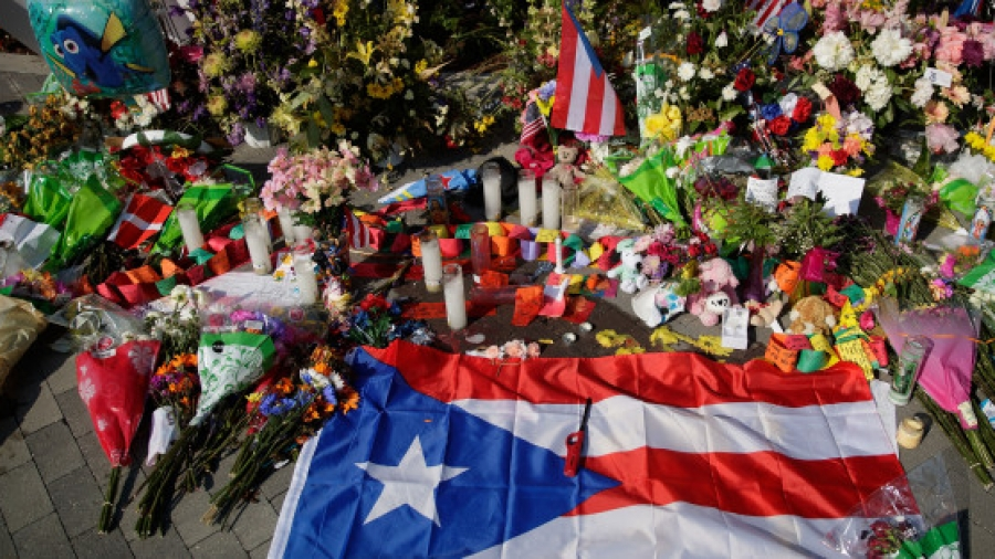 ORLANDO, FL - JUNE 15: A Puerto Rican flag is left at a makeshift memorial near Orlando Regional Medical Center, down the street from the crime scene at Pulse Nightclub, June 15, 2016 in Orlando, Florida. The shooting at Pulse Nightclub, which killed 49 people and injured 53, is the worst mass-shooting event in American history. (Photo by Drew Angerer/Getty Images)